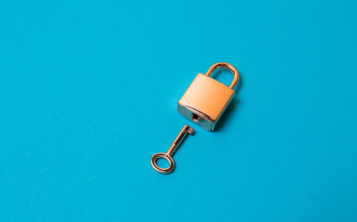 Image of a padlock with a key